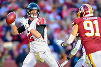 Landover, MD - November 4, 2018: Atlanta Falcons quarterback Matt Ryan (2) throws the football under pressure from Washington Redskins outside linebacker Ryan Kerrigan (91) during game between the Atlanta Falcons and the Washington Redskins at FedEx Field in Landover, MD. The Falcons defeated the Redskins 38-13. (Photo by Phillip Peters/Media Images International)