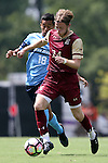 28 August 2016: Elon's Will Smith (NZL) (24) and San Diego's Ulber Perez (18). The Elon University Phoenix played the University of San Diego Toreros at Koskinen Stadium in Durham, North Carolina in a 2016 NCAA Division I Men's Soccer match. USD won the game 2-1.