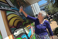 Masterton mayor Lyn Patterson tries her hand at mural artwork in Masterton, New Zealand on Thursday, 19 October 2017. Photo: Dave Lintott / lintottphoto.co.nz