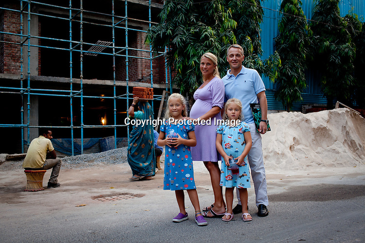 Magnus Oskarsson and his wife Cecilia Oskarsson pose for a photo with their two daughters, Iris and Siri in their neighbourhood in New Delhi, India. Photo: Sanjit Das