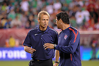 United States head coach Jurgen Klinsmann (L) talks with assistant coach Martin Vasquez (R).The men's national teams of the United States (USA) and Mexico (MEX) played to a 1-1 tie during an international friendly at Lincoln Financial Field in Philadelphia, PA, on August 10, 2011.