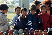 Sofia, Bulgaria. School children looking at a stall selling babushka dolls.