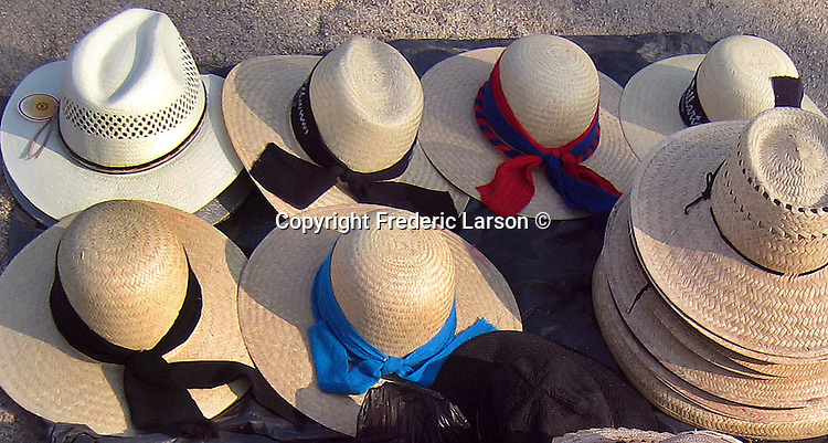A selection of beach hats sold on a beach in Puerto Vallarta, Mexico