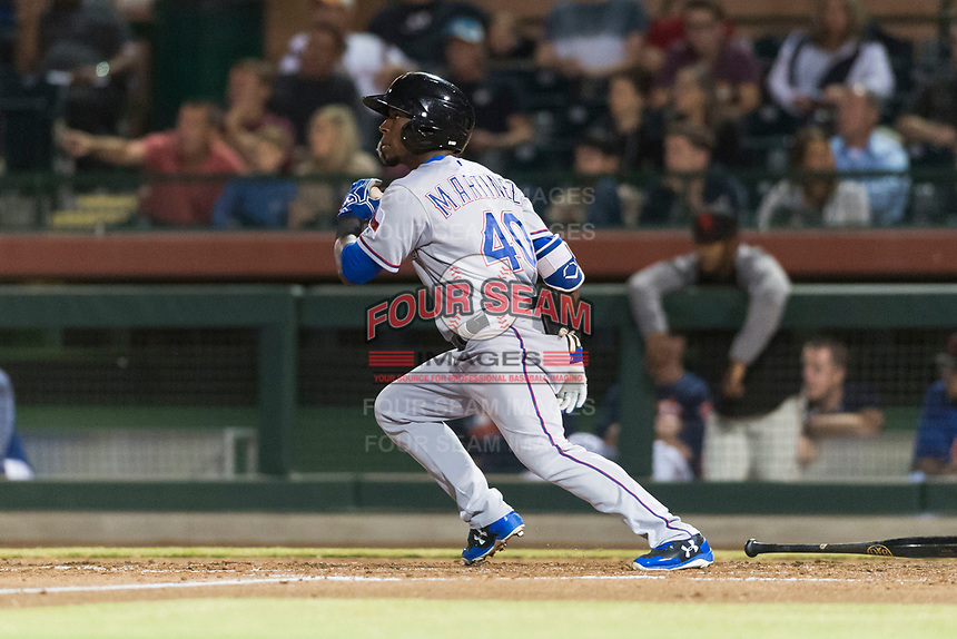 Surprise Saguaros left fielder Julio Pablo Martinez (40), of the Texas Rangers organization, starts down the first base line during an Arizona Fall League game against the Scottsdale Scorpions at Scottsdale Stadium on October 15, 2018 in Scottsdale, Arizona. Surprise defeated Scottsdale 2-0. (Zachary Lucy/Four Seam Images)