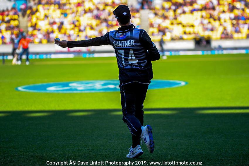 Mitchell Santner fields. Twenty20 International cricket match between NZ Black Caps and England at Westpac Stadium in Wellington, New Zealand on Sunday, 3 November 2019. Photo: Dave Lintott / lintottphoto.co.nz