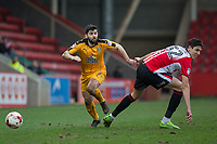 Piero Mingoia of Cambridge United gets away from Tin Plavotic of Cheltenham Town during the Sky Bet League 2 match between Cheltenham Town and Cambridge United at the LCI Stadium, Cheltenham, England on 18 March 2017. Photo by Mark  Hawkins / PRiME Media Images.