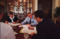 12 Jul 2000, Austin, Texas, USA --- Karen Hughes, George W. Bush, Michael Gerson, and Karl Rove review a draft of Bush's Republican National Convention speech at the Governor's Mansion in Austin. --- Image by © Brooks Kraft/Sygma/Corbis