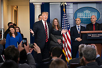 United States President Donald J. Trump enters the White House briefing room in Washington, DC, to maker a statement about border security, January 3, 2019. Standing with Trump are members of agencies associated with border security. <br /> CAP/MPI/RS<br /> &copy;RS/MPI/Capital Pictures