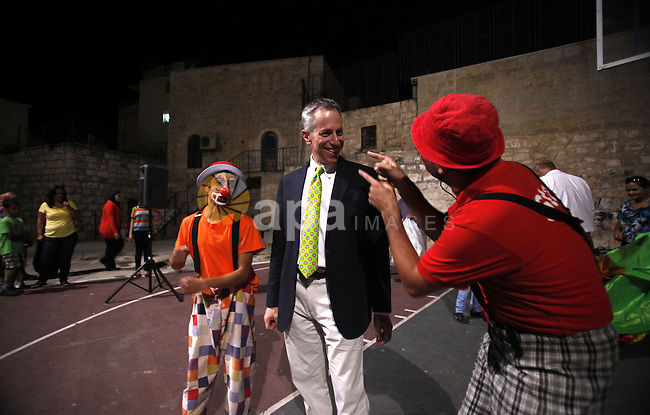 U.S. Consul General in Jerusalem, Michael Ratne participate in a festival for children during the fasting month of Ramadan in the city of Jerusalem, on July 29, 2013. Photo by Saeed Qaq
