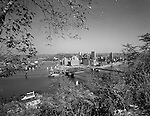 Pittsburgh PA:  View of Pittsburgh from Mount Washington with a view of the Bicentennial Gateway Amphitheater and point bridges - 1959
