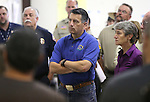 Nevada Gov. Brian Sandoval, center, and Secretary of the Interior Sally Jewell, right, receive a briefing from fire officials on the Washington fire at a command post in Gardnerville, Nev., on Wednesday, June 24, 2015. The lightning-caused fire near Markleeville, Ca. has grown to nearly 17,000 acres since Friday. <br /> Photo by Cathleen Allison