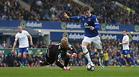 Everton's Ross Barkley rounds Leicester City's goalkeeper Kasper Schmeichel<br /> <br /> Photographer Stephen White/CameraSport<br /> <br /> The Premier League - Everton v Leicester City - Sunday April 9th 2017 - Goodison Park - Liverpool<br /> <br /> World Copyright &copy; 2017 CameraSport. All rights reserved. 43 Linden Ave. Countesthorpe. Leicester. England. LE8 5PG - Tel: +44 (0) 116 277 4147 - admin@camerasport.com - www.camerasport.com