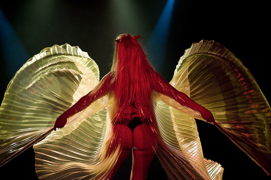 """Infamous Nina Nightshade performs in """"The Dark Crystal"""" at the Geekleseque Sallies Fourth, performance in Portland. The act begins with the green-faced monster, Fizzing, who after metamorphosis is transformed in to a stripping woman with wings."""