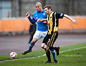 Montrose's Leighton McIntosh is stopped by Berwick's Damian Gielty (3).