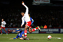 Chuks Aneke of Stevenage (on loan from Arsenal) is tackled by Scott Cuthbert of Leyton Orient.- Stevenage v Leyton Orient- npower League 1 - Lamex Stadium, Stevenage - 2nd January 2012  .© Kevin Coleman 2012