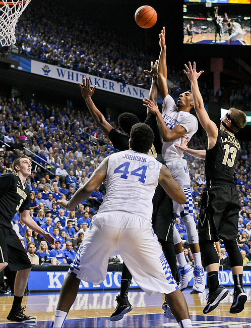 Kentucky forward Marcus Lee shoots over the Vanderbilt defense during the second half of the University of Kentucky vs. Vanderbilt game at the Rupp Arena in Lexington, Ky., on Tuesday, January 20, 2015. Photo by Jonathan Krueger | Staff