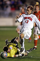 Clemson goalkeeper Phil Marfuggi (left) cannot reach the ball, but forces New Mexico's David Gualdarama (13) wide enough to allow the Clemson defense to recover. The University of New Mexico defeated Clemson University 2-1 in the NCAA Semifinal at SAS Stadium in Cary, North Carolina, Friday, December 9, 2005.