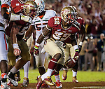 FSU running back James Wilder Jr. celebrates a touchdown as the #3 ranked Florida State Seminoles defeat the #7 ranked Miami Hurricanes 41-14 in Tallahassee, FL November 3, 2013.