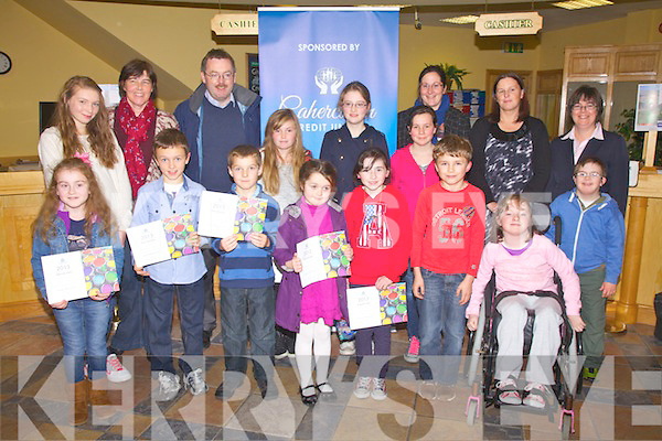 Winners of the Cahersiveen Credit Union 'Gotta Lotta Colour' colouring competition pictured front l-r; Clara Daly, Breece O'Sullivan, Darren O'Donoghue, Ella Corcoran, Alannah Sheehan, Grace O'Connell, Shannon O'Donnell, Abbie Daly, Arnas Balzarvicius, Hannah O'Sullivan, Daniel Casey, back l-r; Bláithín Collins, Bernadette O'Driscoll(Director), Michael O'Connell(Chairman), Lorraine O'Driscoll(Director), Áine O'Connor(Director) & Elma Shine(Manager CCU).