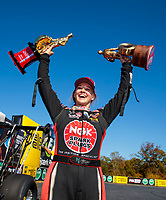 Oct 14, 2019; Concord, NC, USA; NHRA top alcohol dragster driver Megan Meyer celebrates after clinching the 2019 championship after winning the Carolina Nationals at zMax Dragway. Mandatory Credit: Mark J. Rebilas-USA TODAY Sports