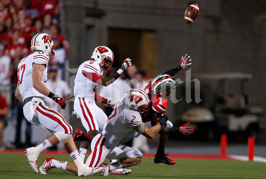 Ohio State Buckeyes running back Dontre Wilson (1) tosses the ball out of bounds as he gets taken down by Wisconsin Badgers safety Michael Caputo (7) in the first quarter of the NCAA football game at Ohio Stadium in Columbus, Saturday evening, September 28, 2013. The Ohio State Buckeyes defeated the Wisconsin Badgers 31 - 24. (Columbus Dispatch  / Eamon Queeney)