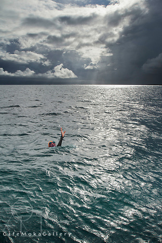 Storm clouds, sunbeams and a lone swimmer. from Gosier towards Basse Terre