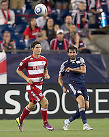 New England Revolution midfielder Monsef Zerka (19) clears the ball. In a Major League Soccer (MLS) match, the New England Revolution defeated FC Dallas, 2-0, at Gillette Stadium on September 10, 2011.