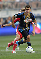 CHESTER, PA - AUGUST 12, 2012:  Michael Farfan (21) of the Philadelphia Union moves away from  Chris Rolfe (18) of the Chicago Fire during an MLS match at PPL Park, in Chester, PA on August 12. Fire won 3-1.