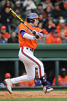 Right fielder Steven Duggar (9) of the Clemson Tigers gets a hit in the second inning of a game against the South Carolina Gamecocks on Saturday, March 2, 2013, at Fluor Field at the West End in Greenville, South Carolina. Clemson won the Reedy River Rivalry game 6-3. (Tom Priddy/Four Seam Images)