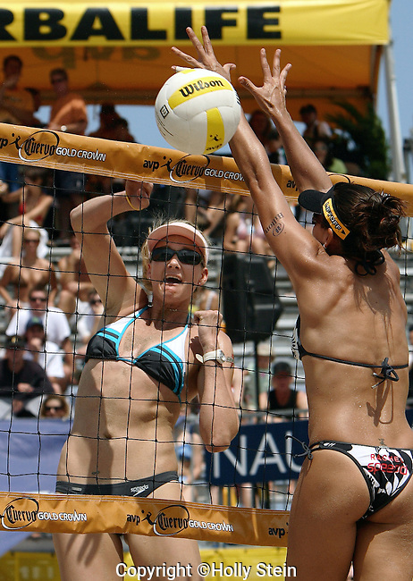 Kerri Walsh (L) hits the ball past Rachel Wacholder during the AVP Ft. Lauderdale Open.