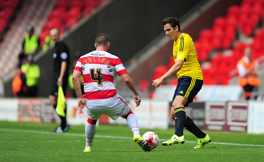 Middlesbrough&rsquo;s Stewart Downing vies for possession with Doncaster Rovers' Luke McCullough<br /> <br /> Photographer Chris Vaughan/CameraSport<br /> <br /> Football - Pre-Season Friendly - Doncaster Rovers v Middlesbrough - Saturday 25th July 2015 - Keepmoat Stadium, Doncaster<br /> <br /> &copy; CameraSport - 43 Linden Ave. Countesthorpe. Leicester. England. LE8 5PG - Tel: +44 (0) 116 277 4147 - admin@camerasport.com - www.camerasport.com