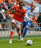 Blackpool's Nathan Delfouneso gets away from Portsmouth's Ronan Curtis<br /> <br /> Photographer Alex Dodd/CameraSport<br /> <br /> The EFL Sky Bet League One - Blackpool v Portsmouth - Saturday August 11th 2018 - Bloomfield Road - Blackpool<br /> <br /> World Copyright &copy; 2018 CameraSport. All rights reserved. 43 Linden Ave. Countesthorpe. Leicester. England. LE8 5PG - Tel: +44 (0) 116 277 4147 - admin@camerasport.com - www.camerasport.com