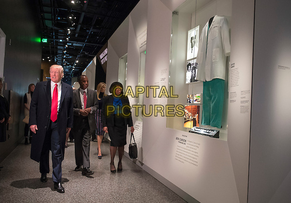 United States President Donald Trump, joined by Dr. Ben Carson and his wife Candy, visit the Ben Carson exhibit as they tour the Smithsonian National Museum of African American History &amp; Culture in Washington, D.C. on February 21, 2017. <br /> CAP/MPI/CNP/RS<br /> &copy;RS/CNP/MPI/Capital Pictures