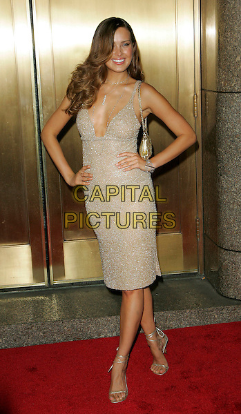 PETRA NEMCOVA.Arrivals at the Conde Nast Media Group's Third Annual Fashion Rocks Concert, held at Radio City Music Hall, .New York City, NY, USA,7 September 2006..full length hands on hips gold sparkly dress low cut plunging neckline bag shoes.Ref: ADM/JL.www.capitalpictures.com.sales@capitalpictures.com.©Jackson Lee/AdMedia/Capital Pictures.
