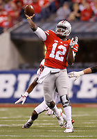 Ohio State Buckeyes quarterback Cardale Jones (12) launches a 42-yard touchdown pass to Ohio State Buckeyes wide receiver Devin Smith (9) during the third quarter of the Big Ten Championship game against the Wisconsin Badgers at Lucas Oil Stadium in Indianapolis on Dec. 6, 2014. (Adam Cairns / The Columbus Dispatch)
