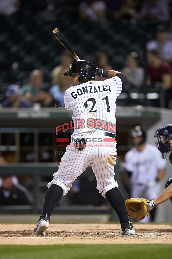 Alfredo Gonzalez (21) of the Charlotte Knights at bat against the Scranton/Wilkes-Barre RailRiders at BB&T BallPark on April 12, 2018 in Charlotte, North Carolina.  The RailRiders defeated the Knights 11-1.  (Brian Westerholt/Four Seam Images)