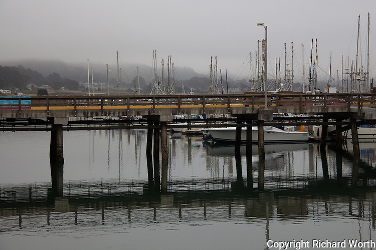 Morning fog hides the hills on a Sunday morning at Pillar Point Harbor.
