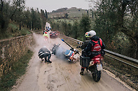 Italian police motorbikes were (way) too heavy and (very) badly suited for the Strade's muddy/slippery surface. Many crashed along the way; mostly with little harm, but always with a mudded uniform...<br /> <br /> 12th Strade Bianche 2018<br /> Siena &gt; Siena: 184km (ITALY)