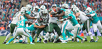 04.10.2015. Wembley Stadium, London, England. NFL International Series. Miami Dolphins versus New York Jets. New York Jets Running Back Chris Ivory finds a gap during a play.