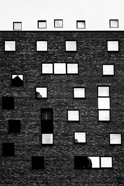 The Photography of strange windows arranged on a house.