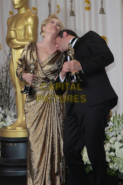 Meryl Streep & Jean Dujardin.84th Annual Academy Awards held at the Hollywood & Highland Center, Hollywood, California, USA..February 26th, 2012.oscars half length black tuxedo gold dress dress award trophy winner winners trophies 3/4 leaning funny bending .CAP/ADM/SLP/JO.©James Orken/ SLP/AdMedia/Capital Pictures.