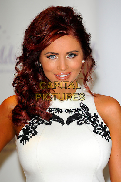 Amy Childs.Photocall to launch her Spring/Summer collection held at The Millenium Hotel, London, England..January 30th, 2013.headshot portrait white lace sleeveless black embroidered .CAP/CJ.©Chris Joseph/Capital Pictures.