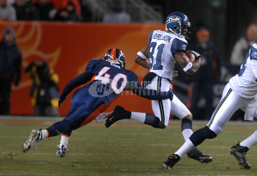 Dec. 3, 2006; Denver, CO, USA; Denver Broncos safety (40) Curome Cox dives for Seattle Seahawks wide receiver (81) Nate Burleson at Invesco Field at Mile High in Denver, Colorado. Seattle defeated Denver 23-20. Mandatory Credit: