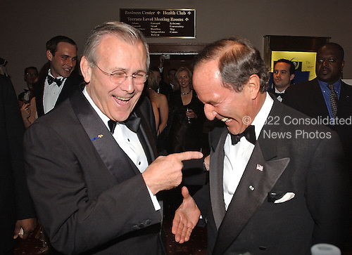 Washington, DC - May 4, 2002 -- United States Secretary of Defense Donald Rumsfeld clowns with New York Daily News and U.S. News and World Report Publisher Mortimer Zuckerman as they arrive at the White House Correspondent's Dinner at the Washington Hilton Hotel in Washington, DC on May 4, 2002.<br /> Credit: Ron Sachs / CNP<br /> <br /> (RESTRICTION: NO New York or New Jersey Newspapers or newspapers within a 75 mile radius of New York City)
