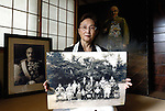 "Yuko Tojo, granddaughter of Japan's wartime leader, General Hideki Tojo, poses with a family photo taken with her grandfather when she was 2 at her home in Tokyo. Gen. Hideki Tojo - who ordered the attack on Pearl Harbor -- was charged and hanged as a war criminal after World War II when Yuko was just 6, and he is enshrined inside the controversial Yasukuni Shrine together with 13 other convicted war criminals. Though she remembers little of her grandfather she still regards him as a hero. ""Japan did not fight a war of aggression but in self-defense,"" says Ms. Tojo, widely seen as a leading figurehead in a recent surge in nationalism in Japan and who unsuccessfully ran for a seat in Japan's House of Councilors in 2007. ""Schoolchildren are told what evil things our country and their ancestors did during the war and this has led to a lack of pride in the Japanese people. This is wrong. We must reinstall a sense of pride and confidence in our children."" Upon running for a seat in Japan's Upper House of Parliament, one of her main goals was to ensure all of Japan's war dead would be enshrined at the central Tokyo shrine."