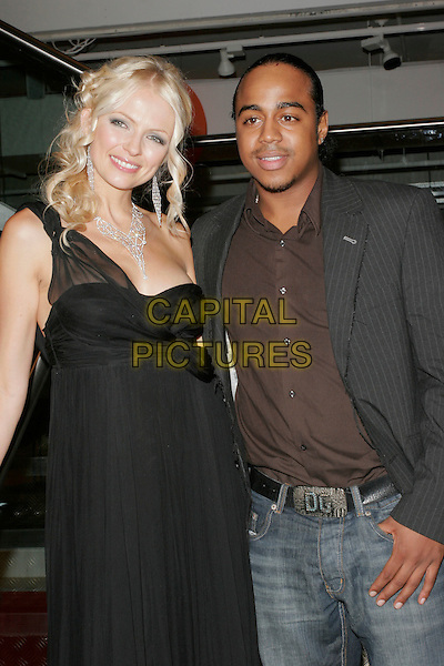"HANNAH SANDLING & BRADLEY McINTOSH.Book Launch Party of ""The Lazy Goddess"", TK Maxx, Kensington High Street, London, England..September 9th, 2008.half length black dress gown diamond necklace suit jacket jeans denim grey gray brown shirt one shoulder .CAP/AH.©Adam Houghton/Capital Pictures."