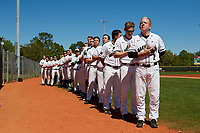 Dartmouth Big Green head coach Bob Whalen (2) and his team stand for the national anthem before a game against the Villanova Wildcats on March 3, 2018 at North Charlotte Regional Park in Port Charlotte, Florida.  Dartmouth defeated Villanova 12-7.  (Mike Janes/Four Seam Images)