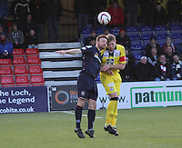 Craig Curran (left) and Marc McAusland challenge in the air in the Ross County v St Mirren Scottish Professional Football League match played at the Global Energy Stadium, Dingwall on 17.1.15.