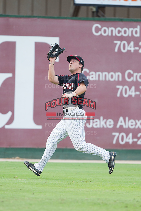 Kannapolis Intimidators left fielder Nolan Early (9) catches a fly ball during the game against the Lakewood BlueClaws at CMC-NorthEast Stadium on July 20, 2014 in Kannapolis, North Carolina.  The Intimidators defeated the BlueClaws 7-6. (Brian Westerholt/Four Seam Images)