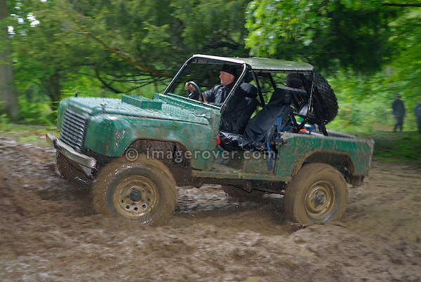 Land Rover based off-road racer competing at the ALRC National 2008 CCVT trial during very bad weather. The Association of Land Rover Clubs (ALRC) National Rallye is the biggest annual motor sport oriented Land Rover event and was hosted 2008 by the Midland Rover Owners Club at Eastnor Castle in Herefordshire, UK, 22 - 27 May 2008. --- No releases available. Automotive trademarks are the property of the trademark holder, authorization may be needed for some uses.